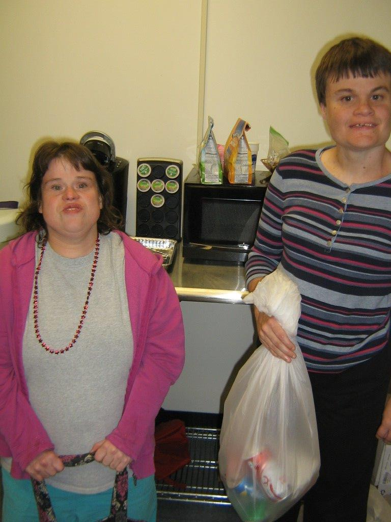 Jessica & Stephanie collect cans